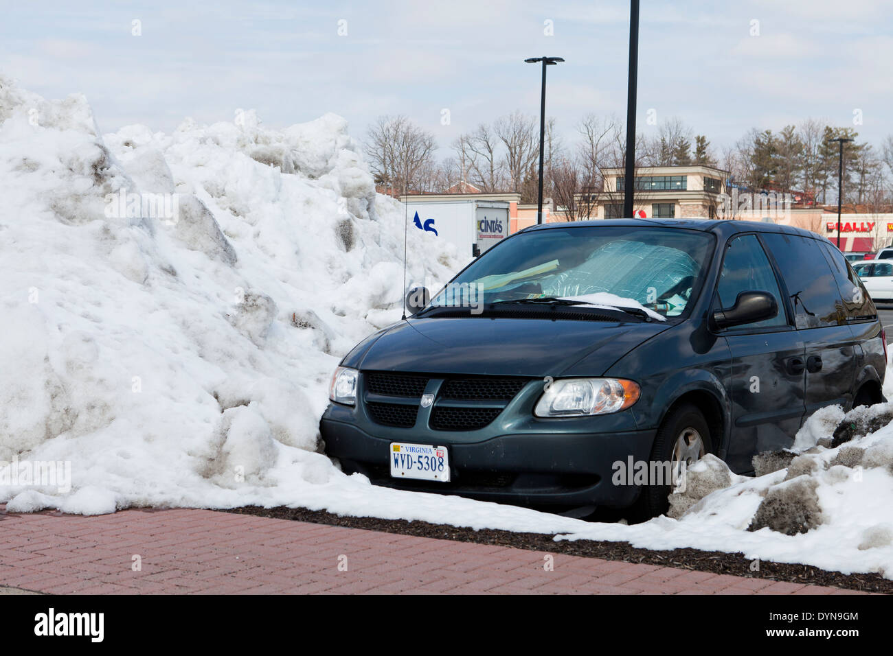 Car blocked by high plowed snow - USA Stock Photo