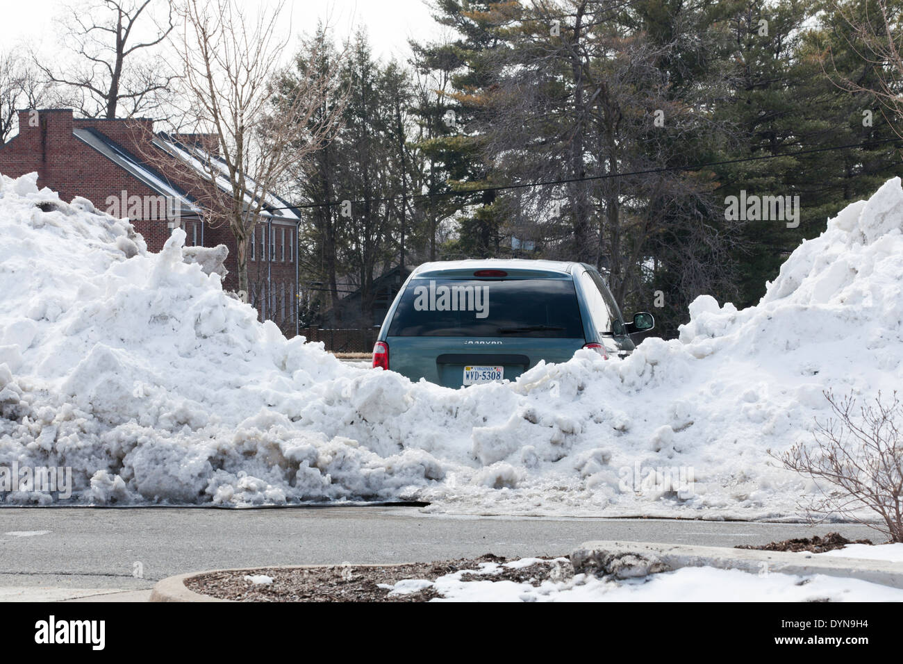 Car blocked by high plowed snow - USA - Stock Image