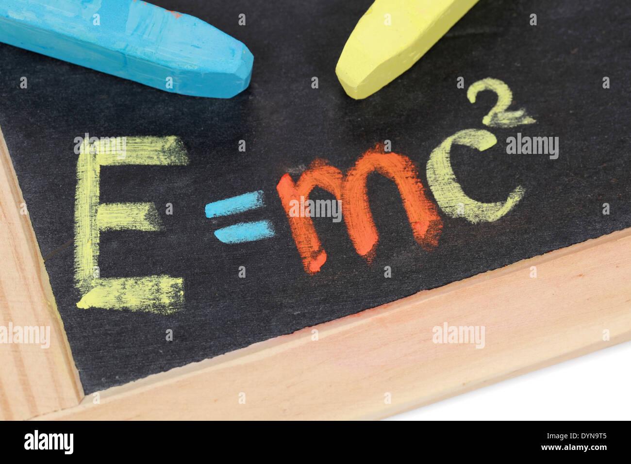 The formula E=mc2 on a blackboard at school - Stock Image