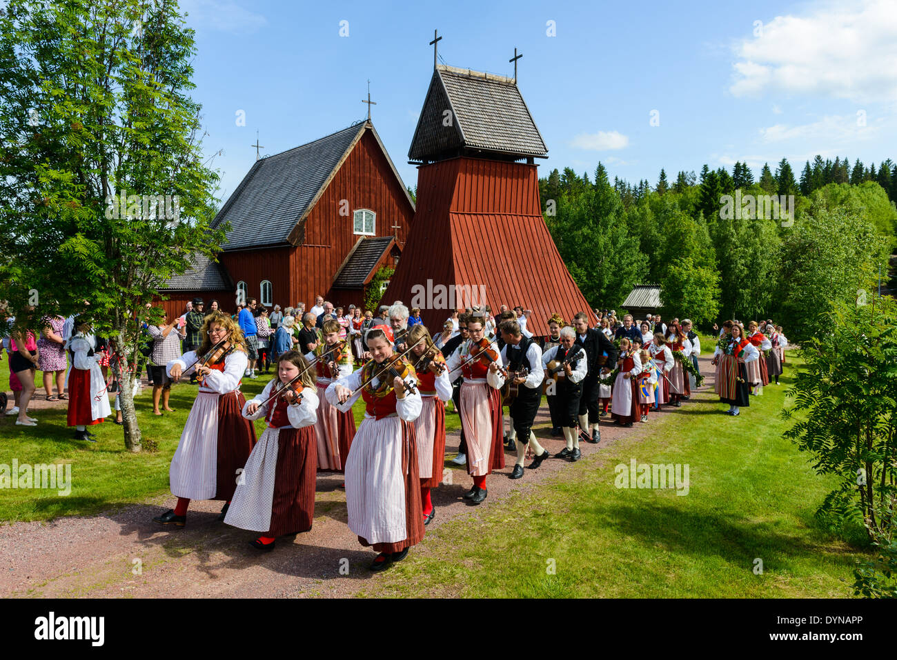 People celebrating midsummer festival, Evertsberg, Dalarna, Sweden - Stock Image