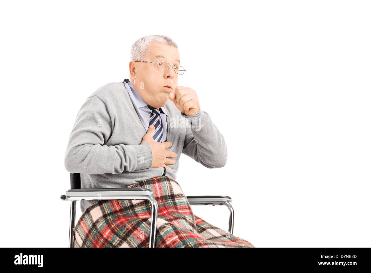Senior man in wheelchair choking - Stock Image