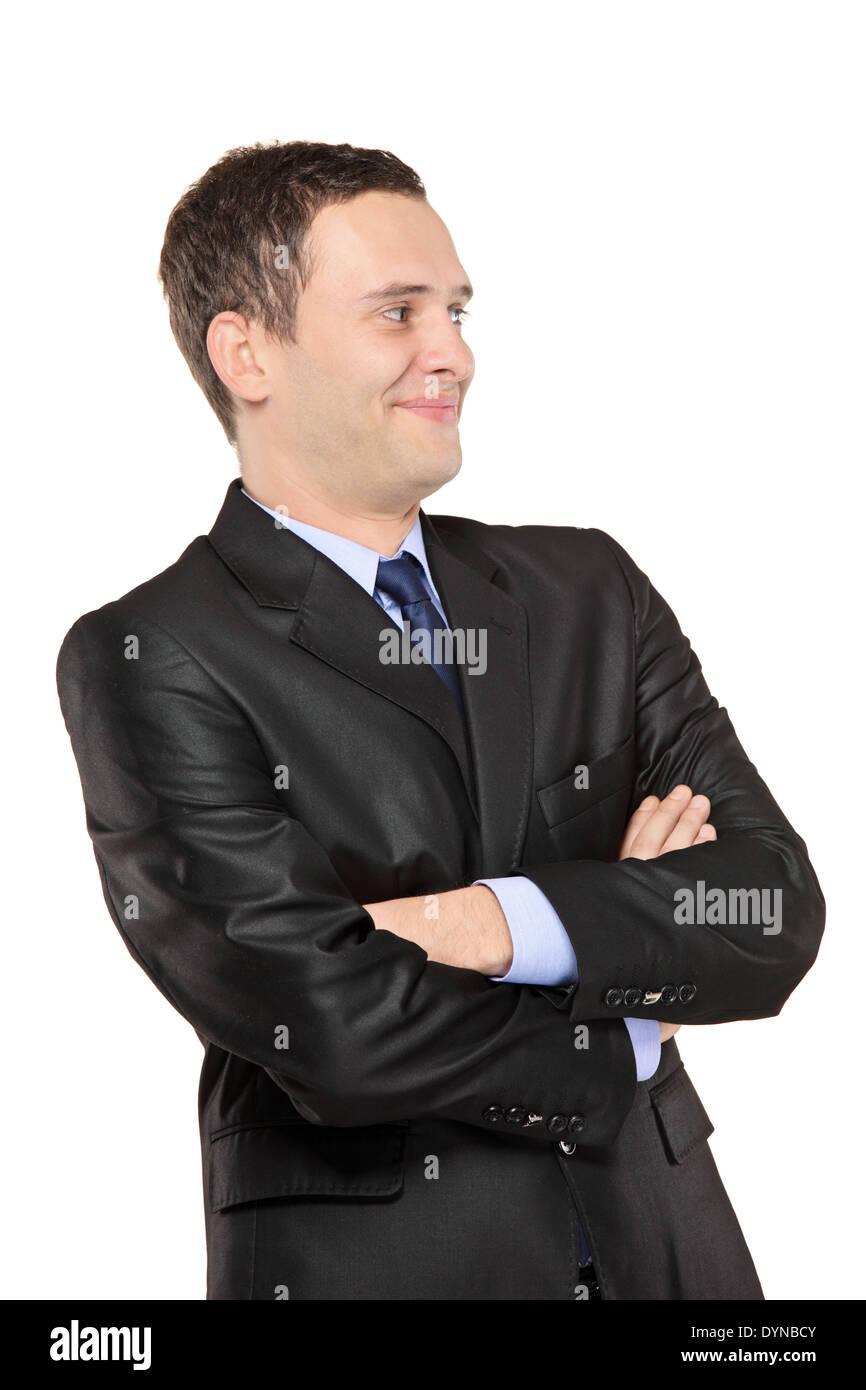 Smiling man posing in black suit - Stock Image
