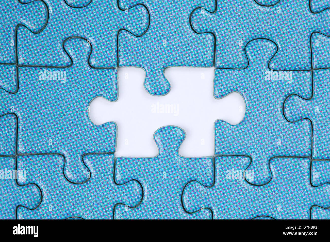 Jigsaw Puzzle with the last missing piece - Stock Image