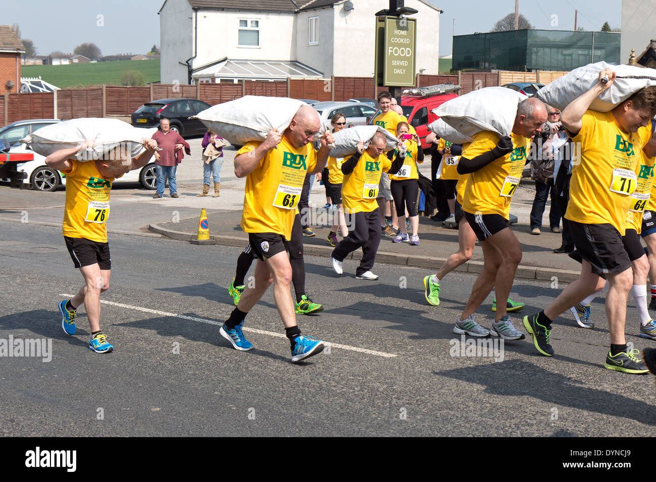 The World Coal Carrying Championship, Gawthorpe, West Yorkshire, Easter Monday 2014.  male contestants at the start of the race - Stock Image