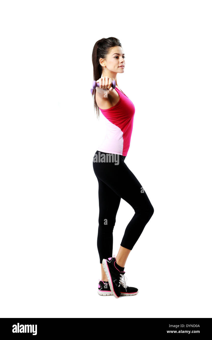 Young beautiful woman with dumbbell working out isolated over white background - Stock Image