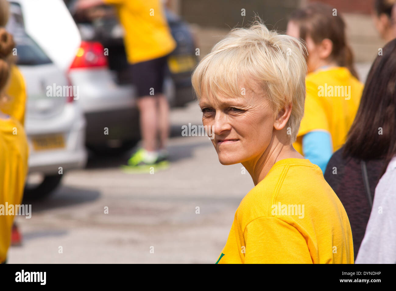 World Coal Carrying Championship, Gawthorpe, West Yorkshire, Easter Monday 2014.  Female contestant at the start of the race - Stock Image