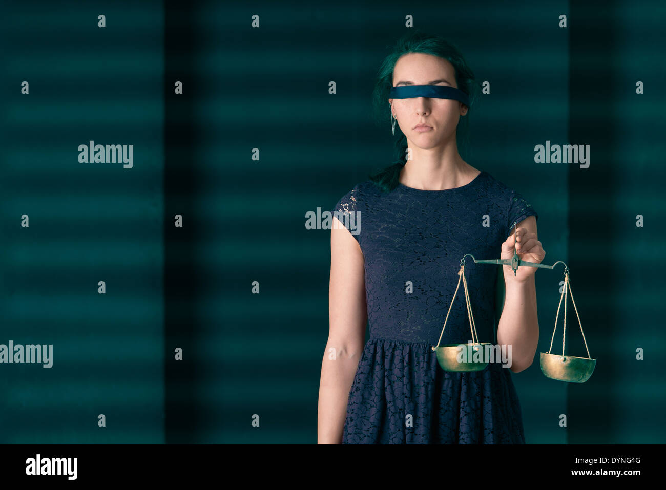 Lady Justice (Justitia) blindfolded holding waight scale. Concept image of law and being equal. - Stock Image