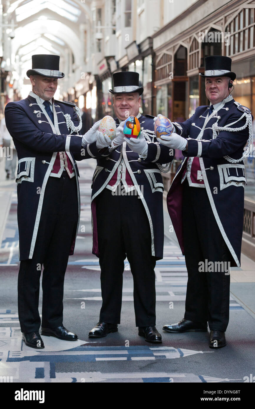 The Beadles of Burlington Arcade hold Jesmonite decorated eggs designed by Royal Academians in support of the RA Schools - Stock Image