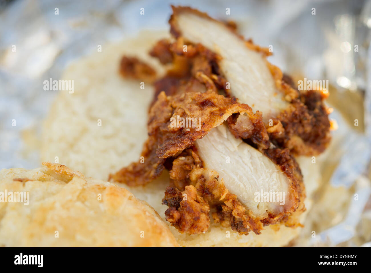 Close-up of fried chicken on a biscuit at the Waverly Farmers Market in Baltimore, Maryland - Stock Image