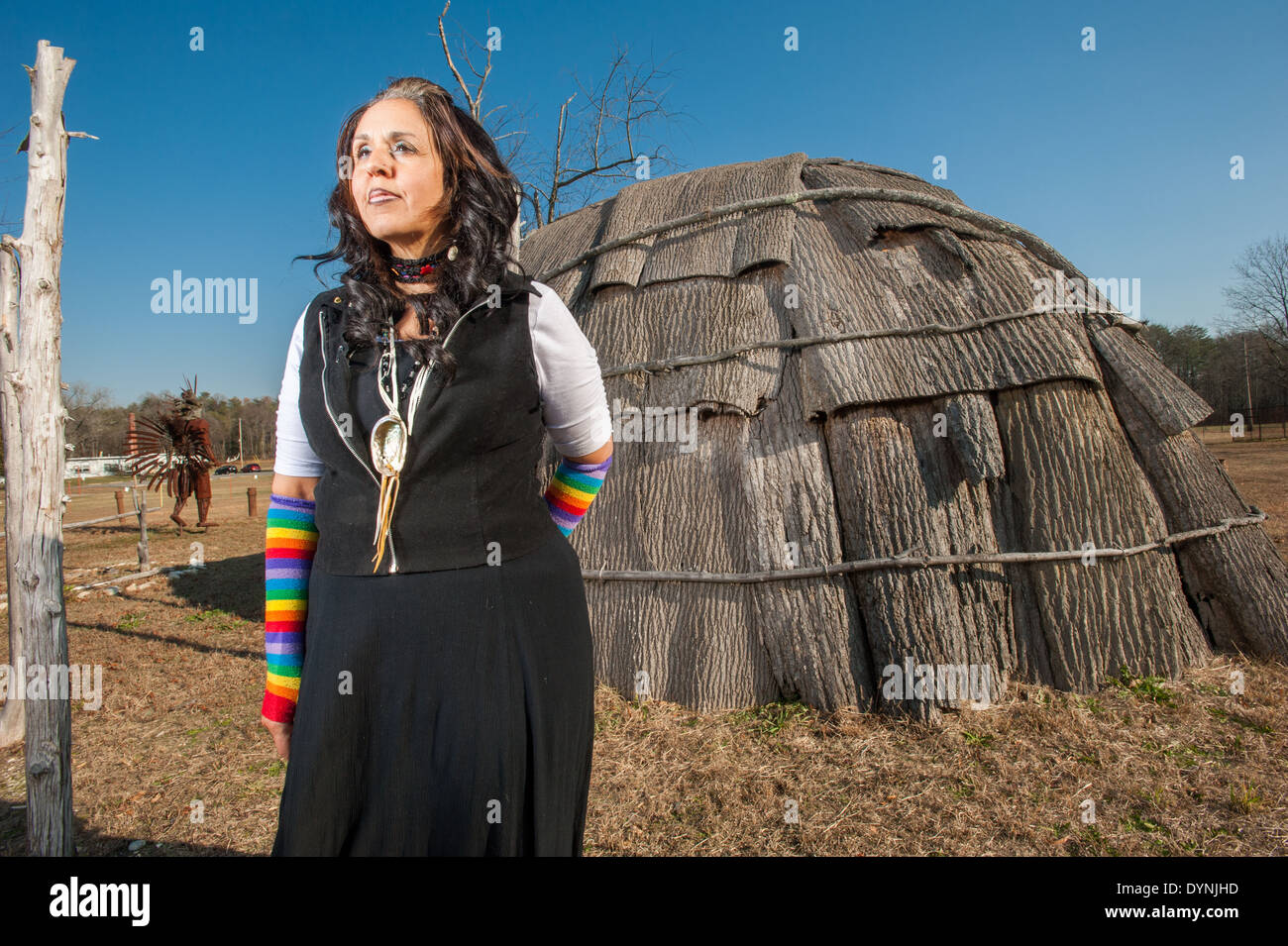 Piscataway Native American woman standing outside near wigwam at the Piscataway indian cultural center in Waldorf MD - Stock Image