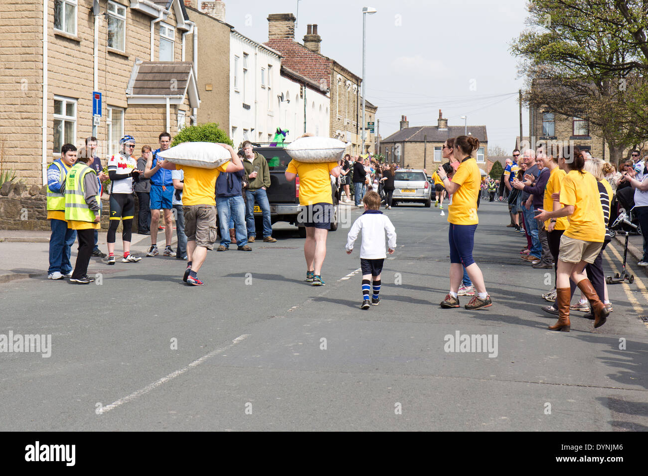 World Coal Carrying Championship, Gawthorpe, West Yorkshire, Easter Monday 2014.  male contestants running the race - Stock Image