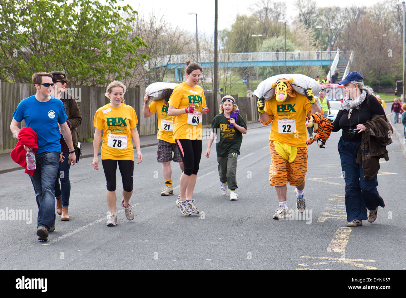 World Coal Carrying Championship, Gawthorpe, West Yorkshire, Easter Monday 2014.  male contestant running the race - Stock Image