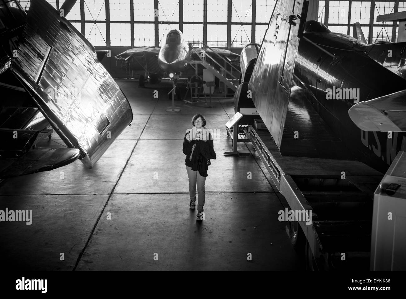Female visitor in hanger at the Naval Air Station Wildwood Aviation Museum, in Cape May, NJ - Stock Image