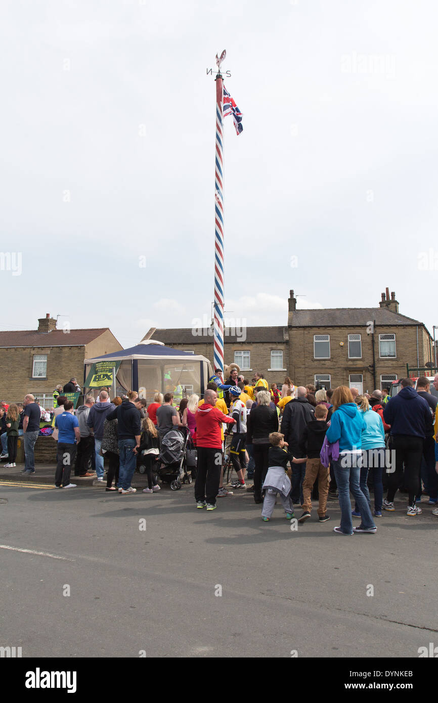 The World Coal Carrying Championship at Gawthorpe, West Yorkshire, on Easter Monday 2014 and the may pole Stock Photo