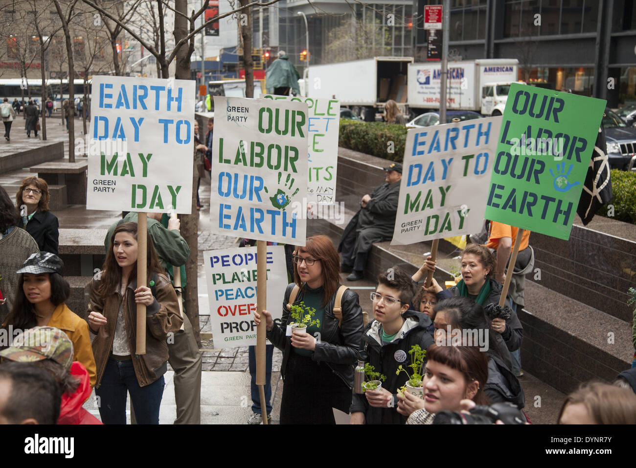 New York, NY, USA . 22nd Apr, 2014. Environmental activists rally on Earth Day at Zuccotti Park, then march to Wall Street calling for system change not climate change. The Occupy movement is still around in NYC it seems. Credit:  David Grossman/Alamy Live News - Stock Image