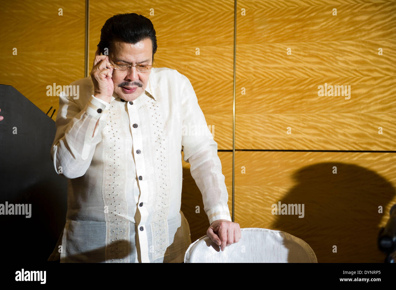 Hong Kong, China. 23rd Apr, 2014. Mayor of Manila Joseph Estrada attends a press conference in Hong Kong, south China, April 23, 2014. The Philippine government expressed its most sorrowful regret and profound sympathy, and extended its most sincere condolences for the pain and suffering of the victims and their families in the bus hostage crisis that happened in Manila in August 2010, according to a joint statement issued by the government of Hong Kong Special Administrative Region and the Philippine government here on Wednesday. © Lui Siu Wai/Xinhua/Alamy Live News - Stock Image