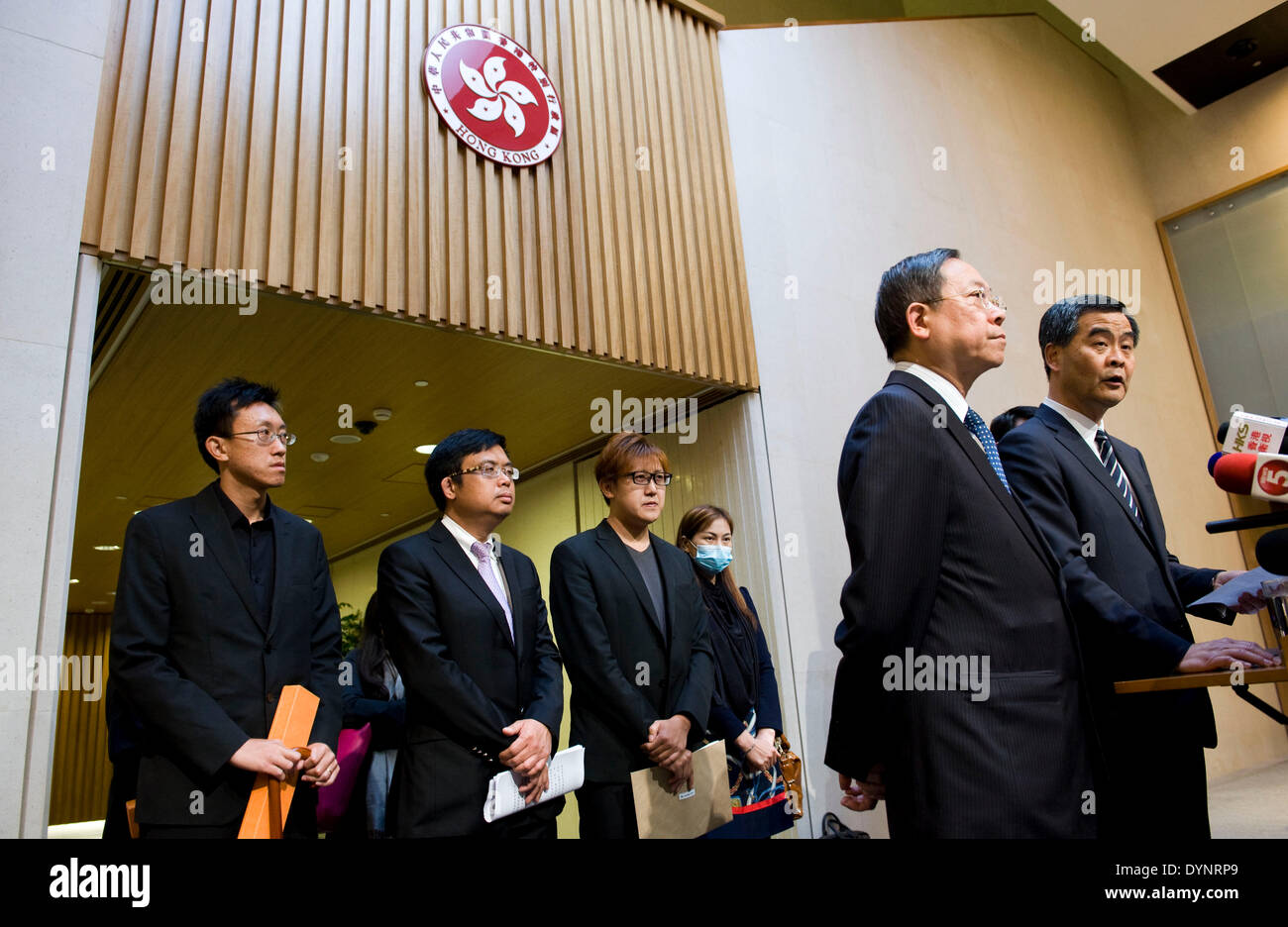 (140423) -- HONG KONG, April 23, 2014 (Xinhua) -- Chief Executive of Hong Kong Special Administrative Region C Y Leung (1st R) attends a press conference in Hong Kong, south China, April 23, 2014. The Philippine government expressed its most sorrowful regret and profound sympathy, and extended its most sincere condolences for the pain and suffering of the victims and their families in the bus hostage crisis that happened in Manila in August 2010, according to a joint statement issued by the government of Hong Kong Special Administrative Region and the Philippine government here on Wednesday. - Stock Image