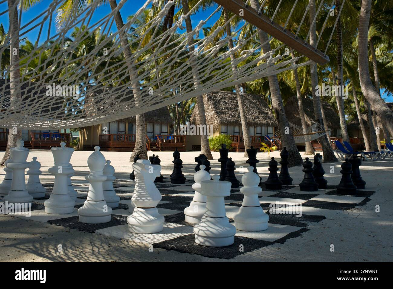 Aitutaki. Cook Island. Polynesia. South Pacific Ocean. Giant chess set on the beach of the Aitutaki Lagoon Resort & Spa Hotel. With a lagoon that is arguably one of the most beautiful in the world, a cruise out on its pristine water is an absolute must. You are likely to be so enchanted, that you'll book another tour for the next day. Back on land, the island of Aitutaki has an interesting history and there are excavations of local marae underway. You can take a safari tour to these ancient places, explore the island and also find out about the legacy of the American troops stationed here duri - Stock Image