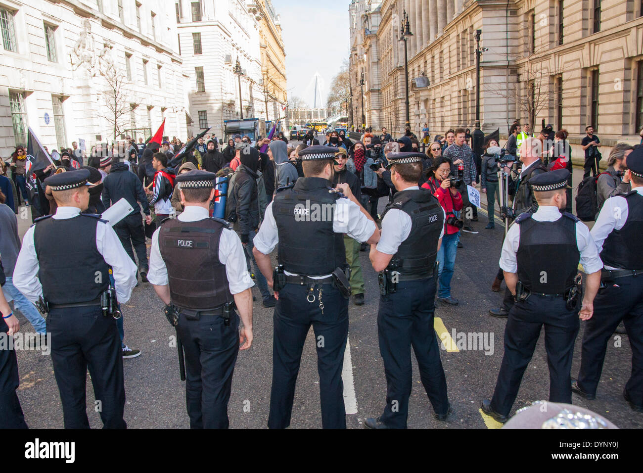 London, March 15th 2014. Police block a charge by anti-fascist counter-protesters from a side street as the English Stock Photo