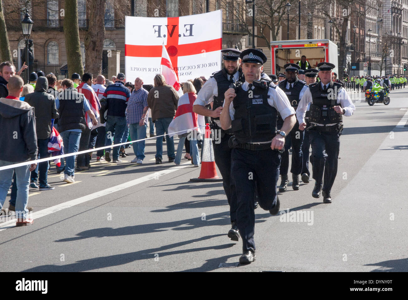 London, March 15th 2014. Police rush in reinforce,ments as counter-protesting anti-fascists attempt an attack on - Stock Image
