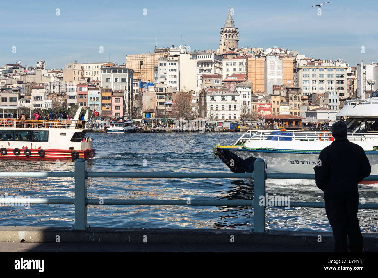 View from Galata bridge with ferries on the Golden Horn. Beyoglu and the Galata tower in the background. Istanbul, Turkey. - Stock Image