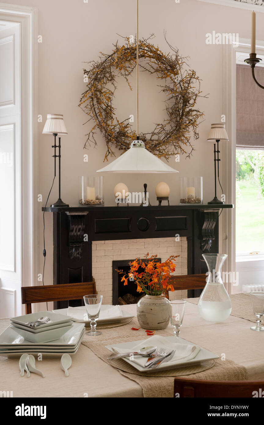 Dining Room With Wreath Over The Fireplace And Table Set Up Crockery