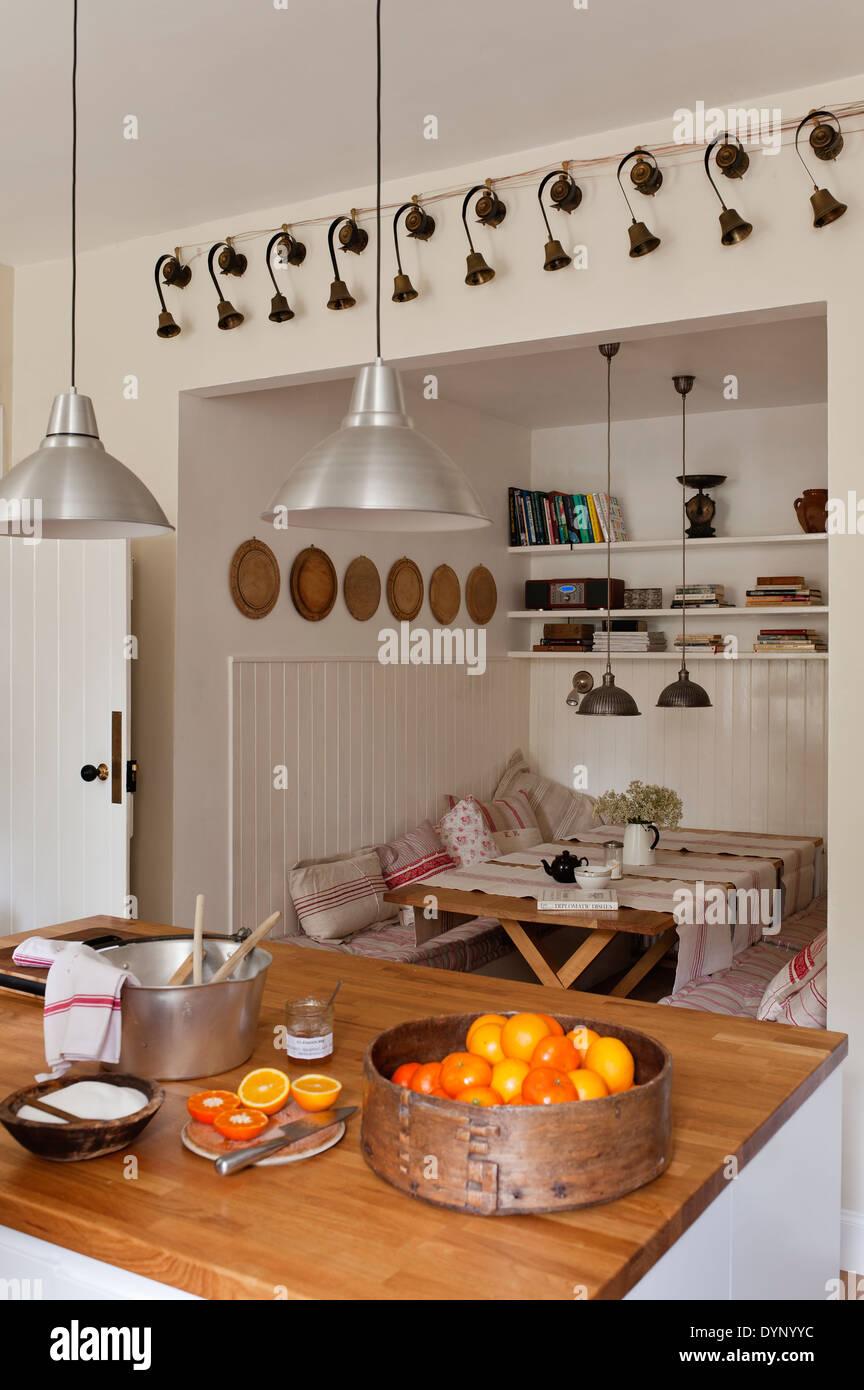 kitchen with oak wood worktop and orange basket - Stock Image