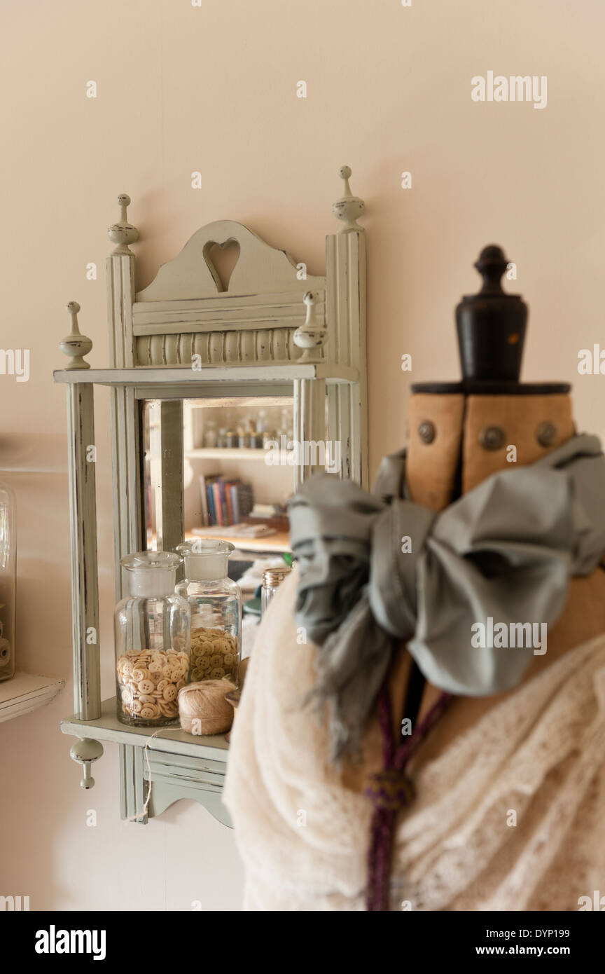 mannequin with bow and mirror - Stock Image