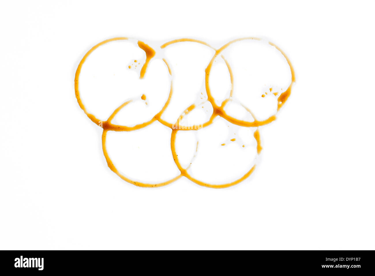 Olympic rings made of coffee drops - Stock Image