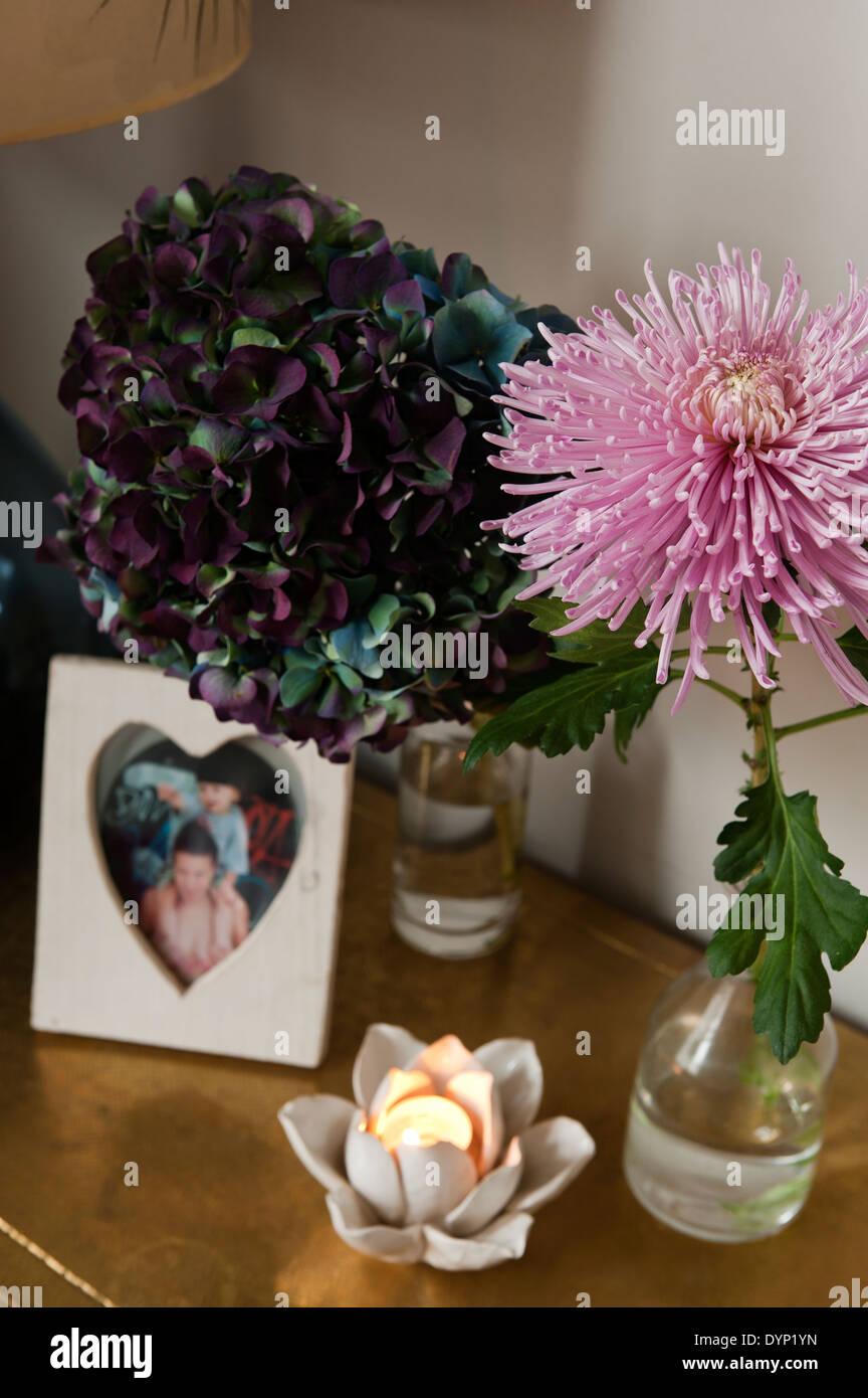 Lotus flower heart stock photos lotus flower heart stock images lotus flower tea light holder on surface with hydrangea flower and pink allium stock image izmirmasajfo