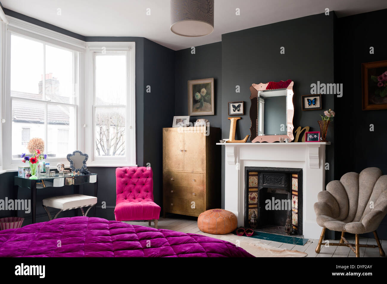 dark painted bedroom with assorted vintage and graham green furniture a purple quilt is on the bed dark furniture f13 purple