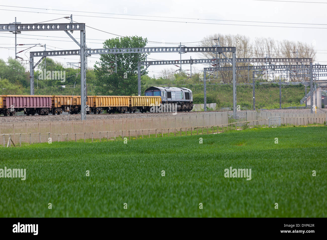 A Direct Rail Services freight train hauling Network Rail bogie ballast wagons. - Stock Image