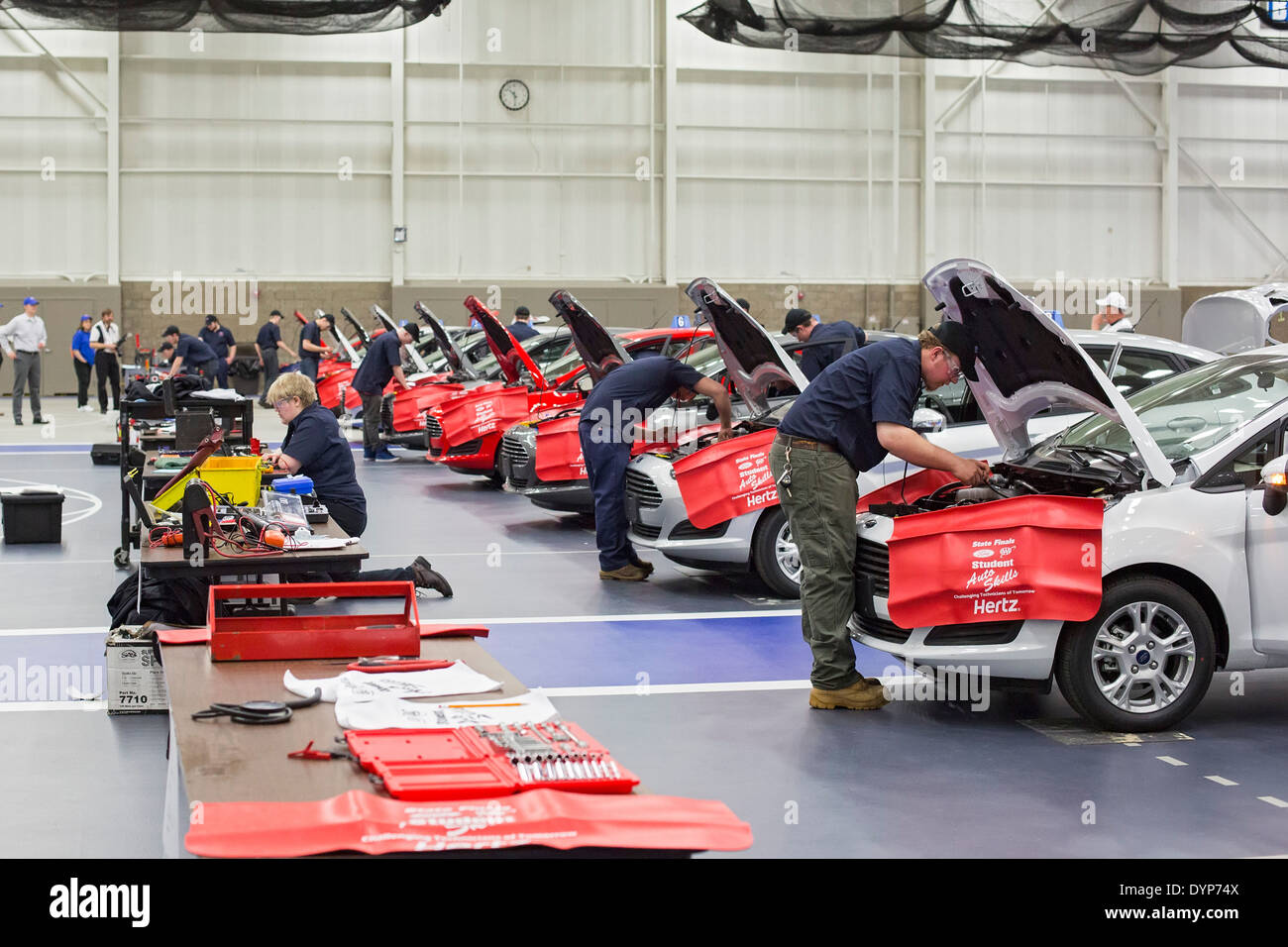 High School Students Participate in Auto Repair Competition - Stock Image