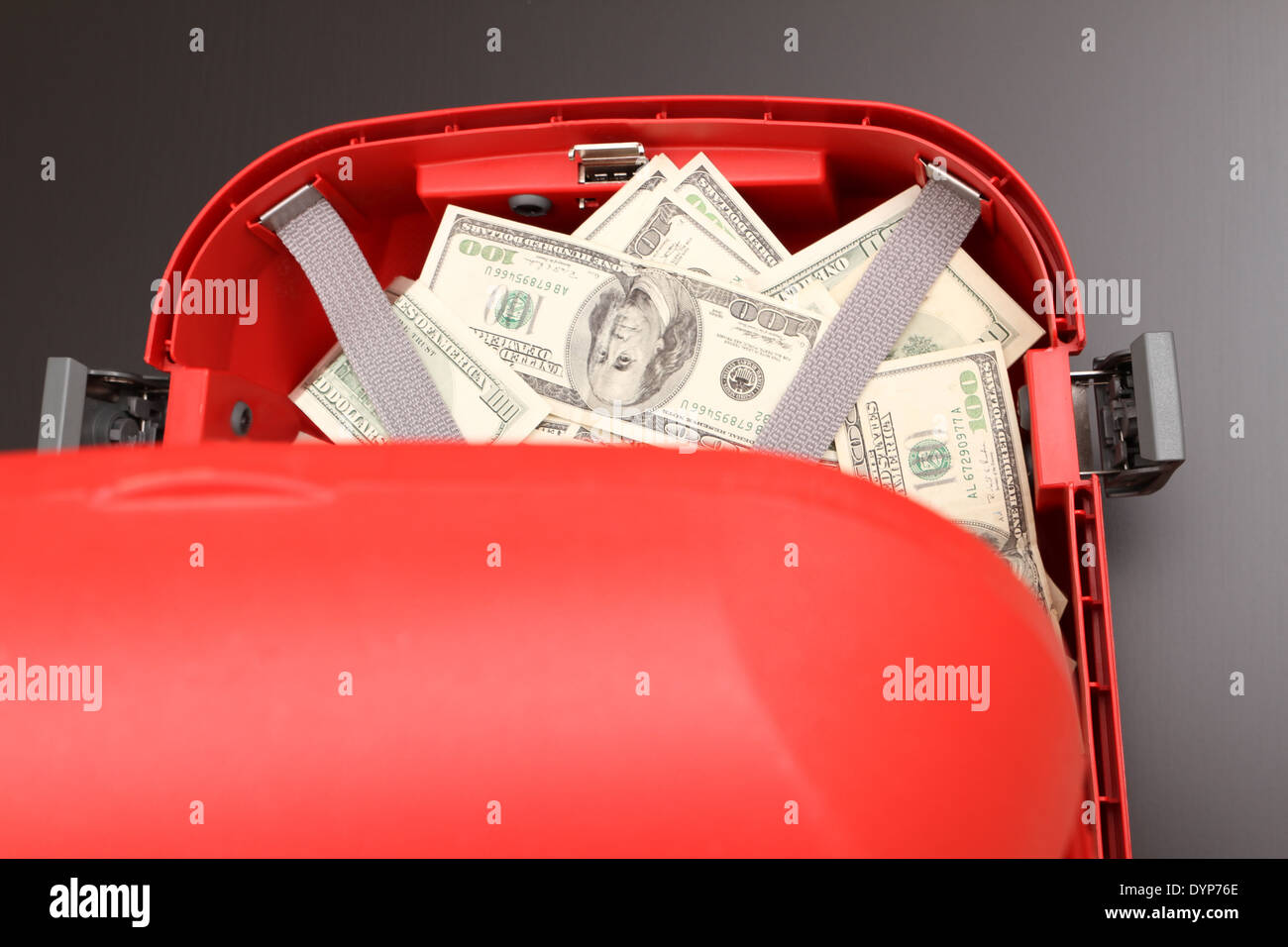 A Suitcase with lots of dollars - Stock Image