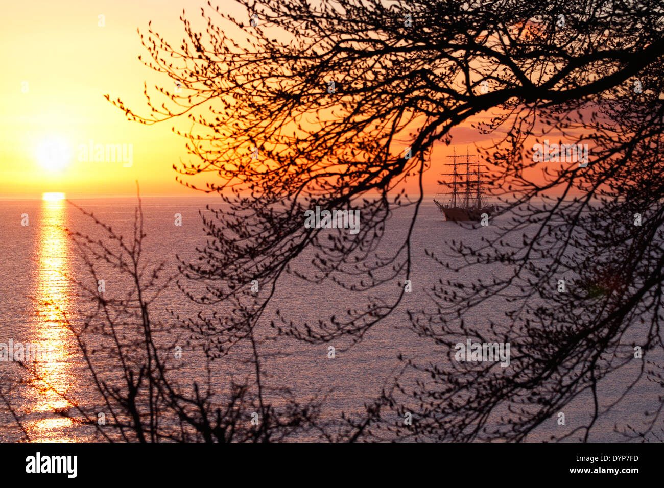 Georg Stage, a three-masted full-rigged Danish training tall ship at sunrise on the Sound in Denmark one spring morning. Ambience. - Stock Image