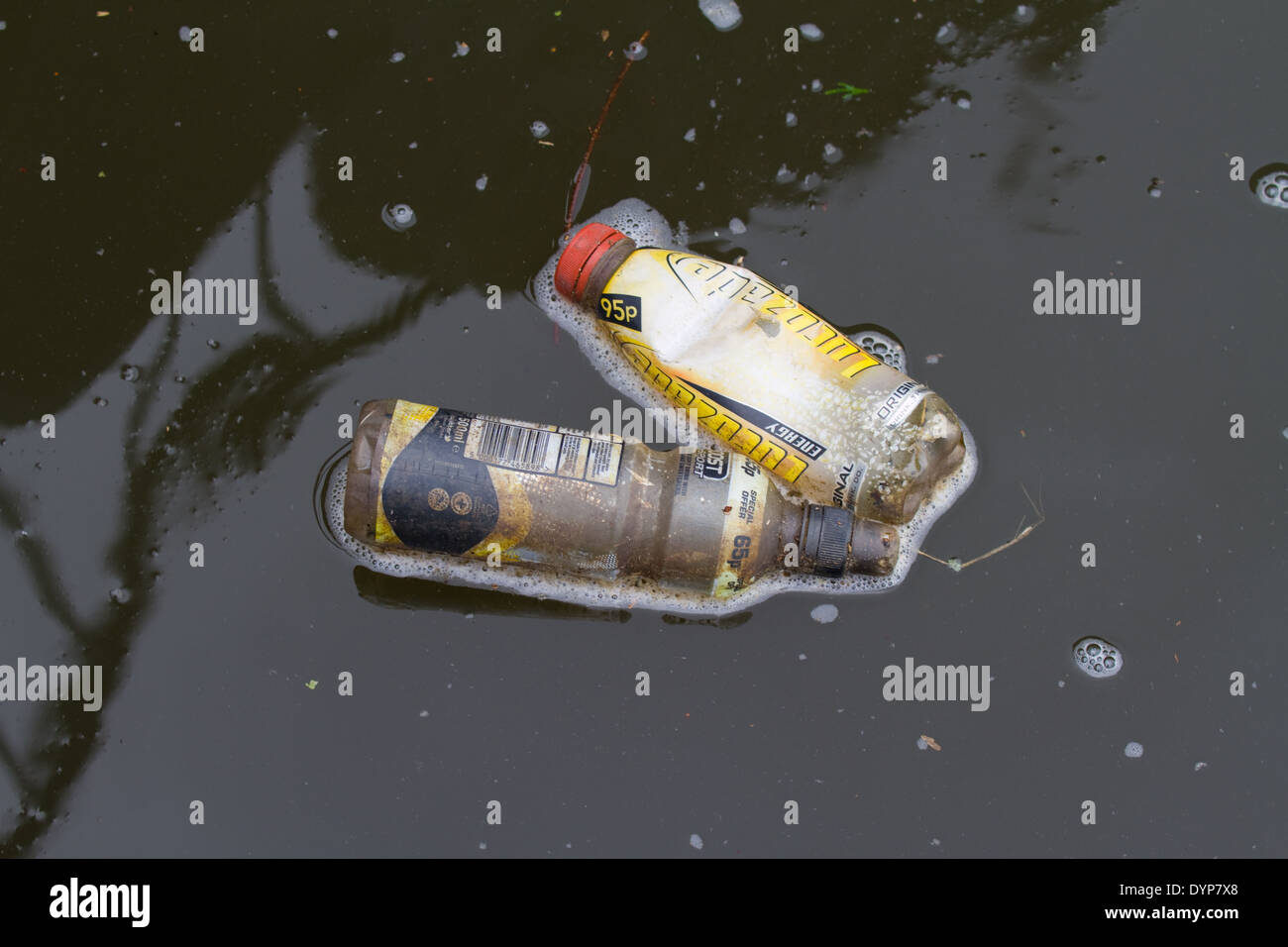 Plastic bottles floating in staffs & worcs canal. uk - Stock Image