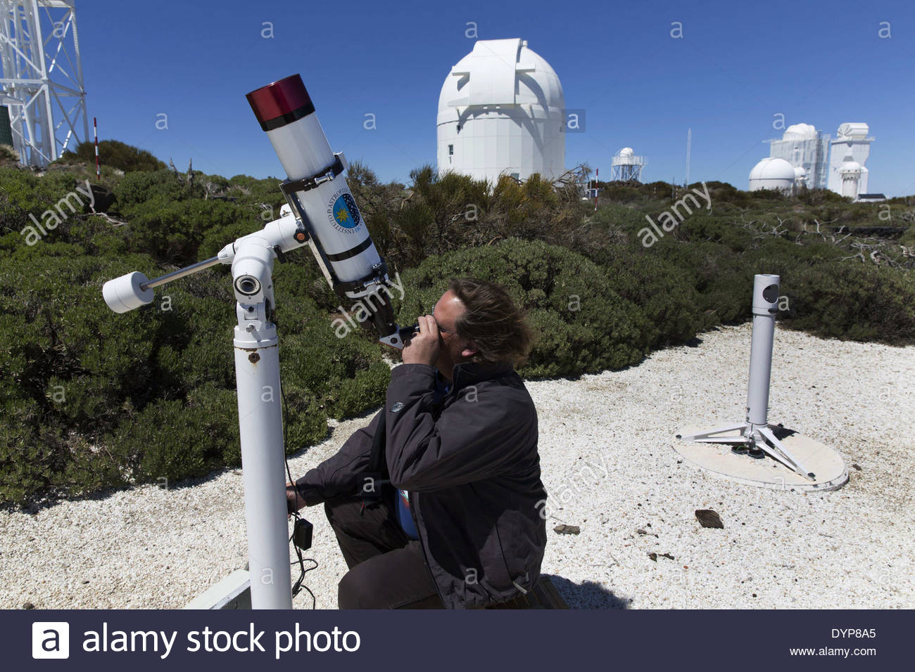 Tenerife, Canary Island, Spain. 21st Apr, 2014. Alfred ROSENBERG GONZALEZ in the Instituto de Astrofisica de Canarias on April 21, 2014. View of telescopes in the Instituto Astrofisico de Canarias (IAC) in Tenerife, Canary Islands, Spain on April 21, 2014. is situated 2.390 metres above sea level in Izaña, an area of Tenerife that lies across three municipal districts - La Orotava, Fasnia and Güímar. The first telescope for studying zodiacal light, light dispersed by interplanetary material, entered service here in 1964. Its geographical location (between the eastern and western solar ob - Stock Image