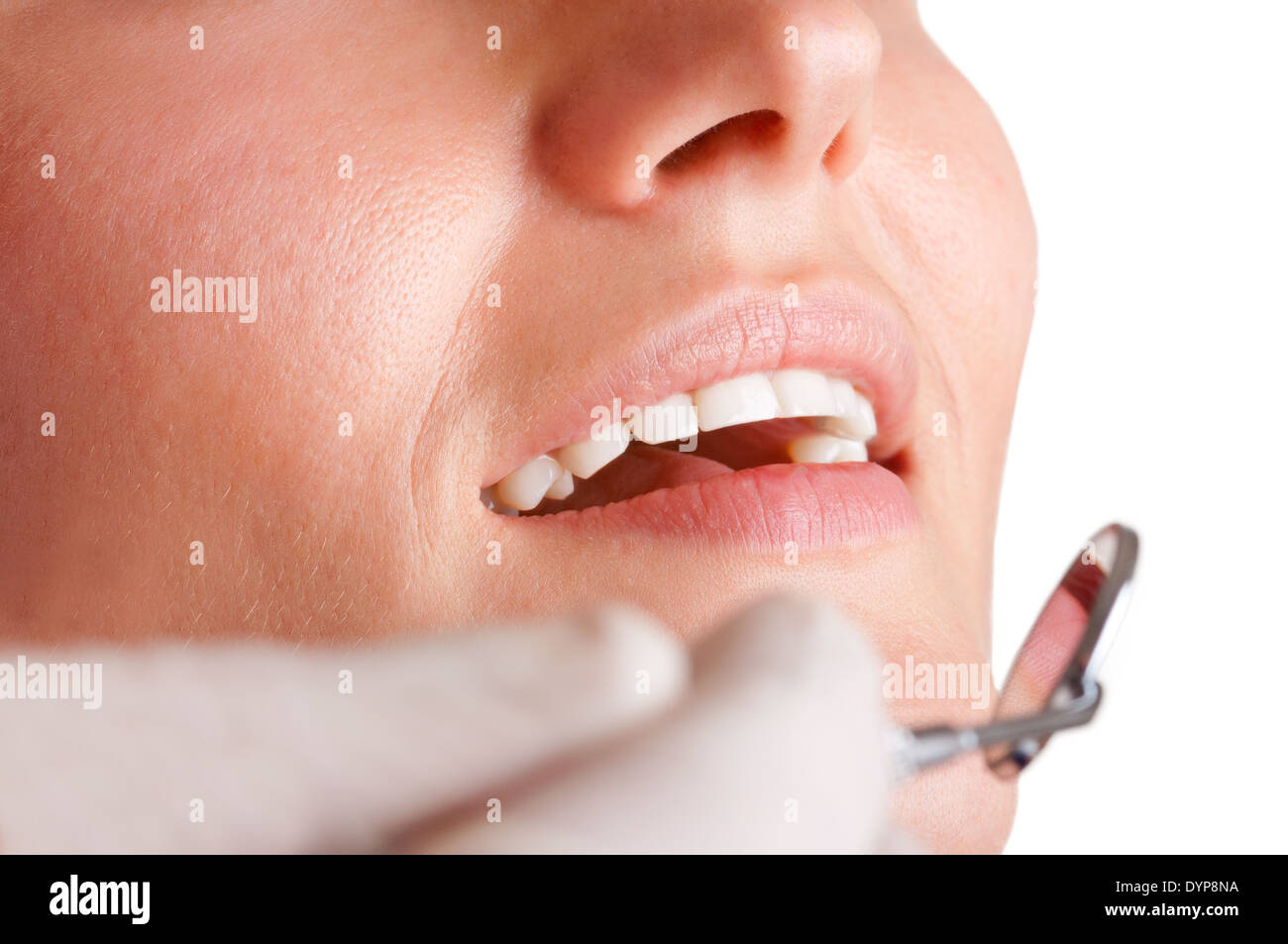 Closeup of a dentist hands about to do a procedure on a patient - Stock Image