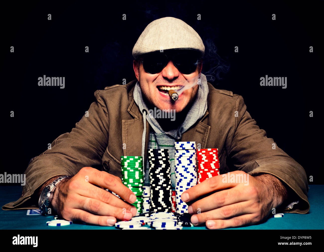 Happy poker face on the man.selective focus on the man head - Stock Image