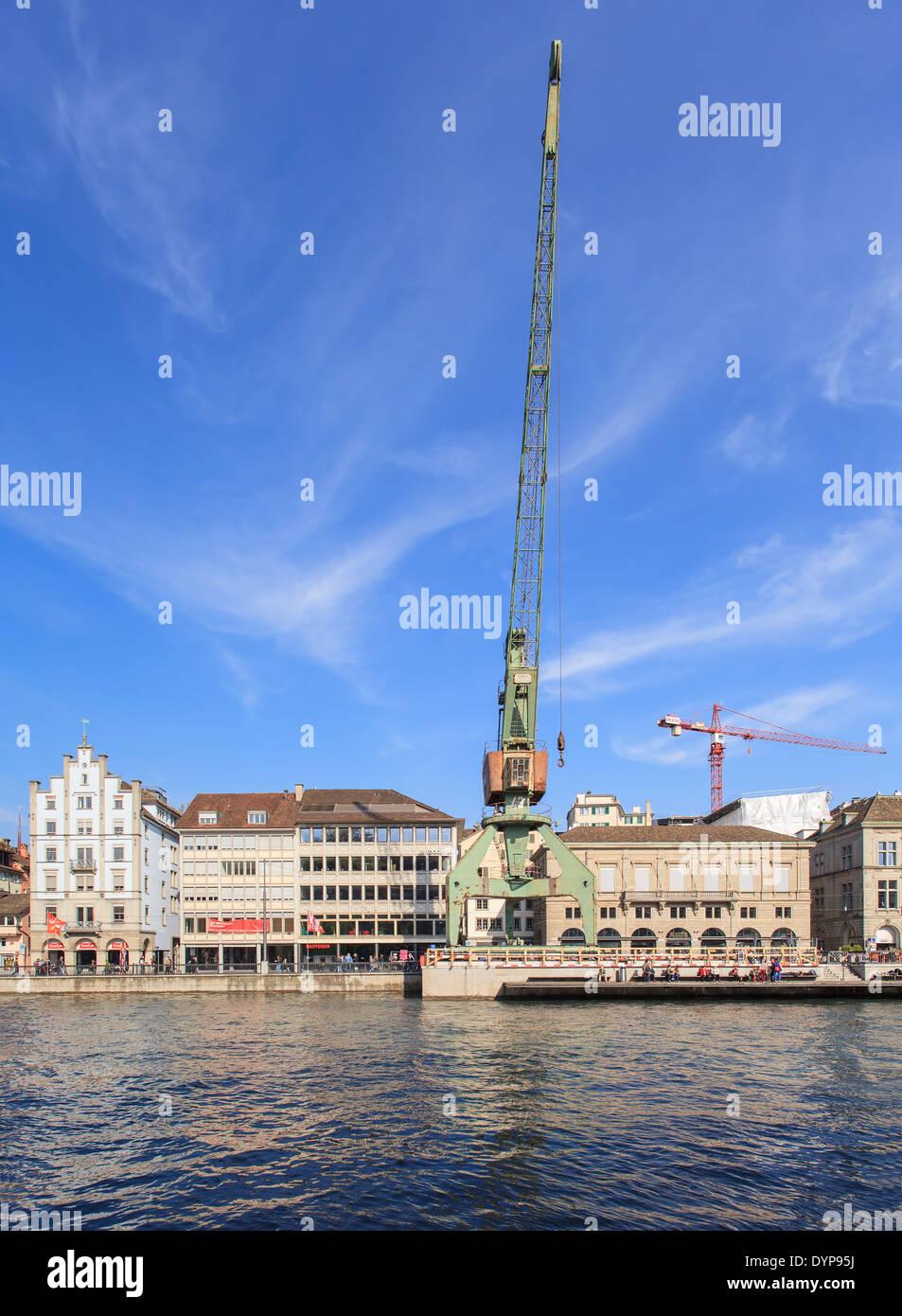 Zurich cityscape with a dockside crane (German: Hafenkran) - Stock Image
