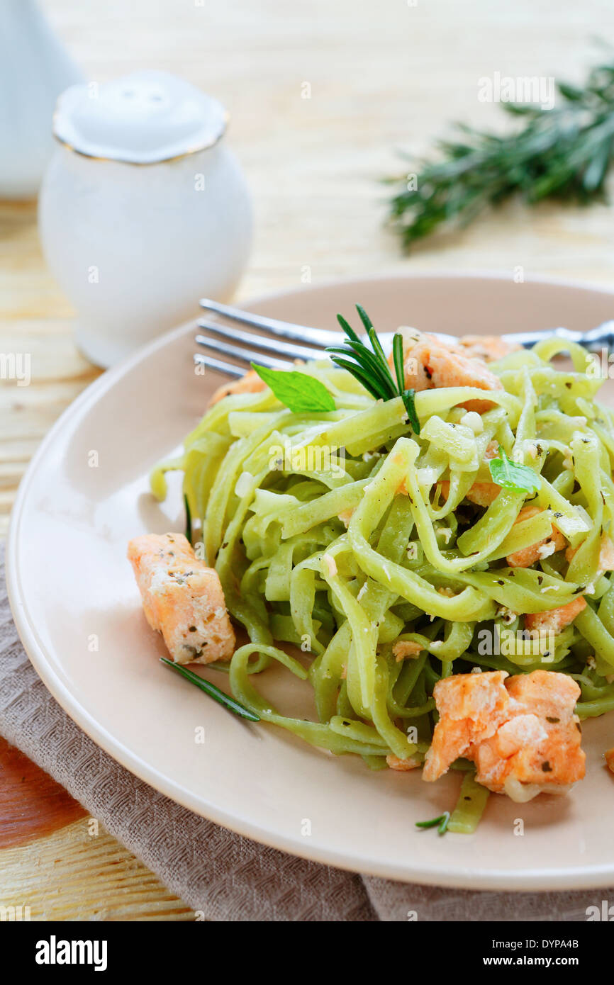 nutritious pasta with slices of fish, food closeup - Stock Image