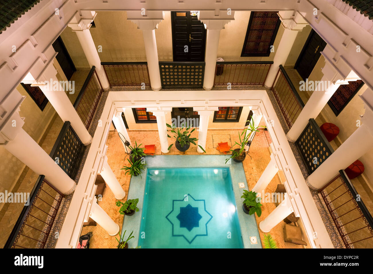 Evening View To Riad Africas Courtyard And Its Swimming Pool Stock