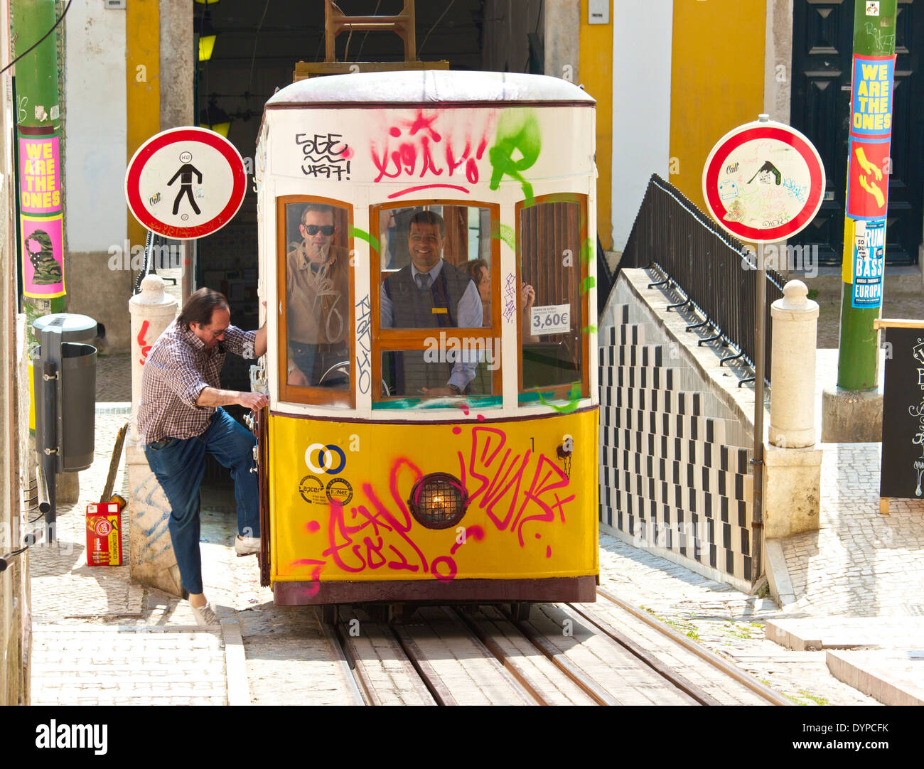Passenger boarding the Elevador da Bica funicular for its steep ascent through district of Bica Lisbon Portugal Stock Photo