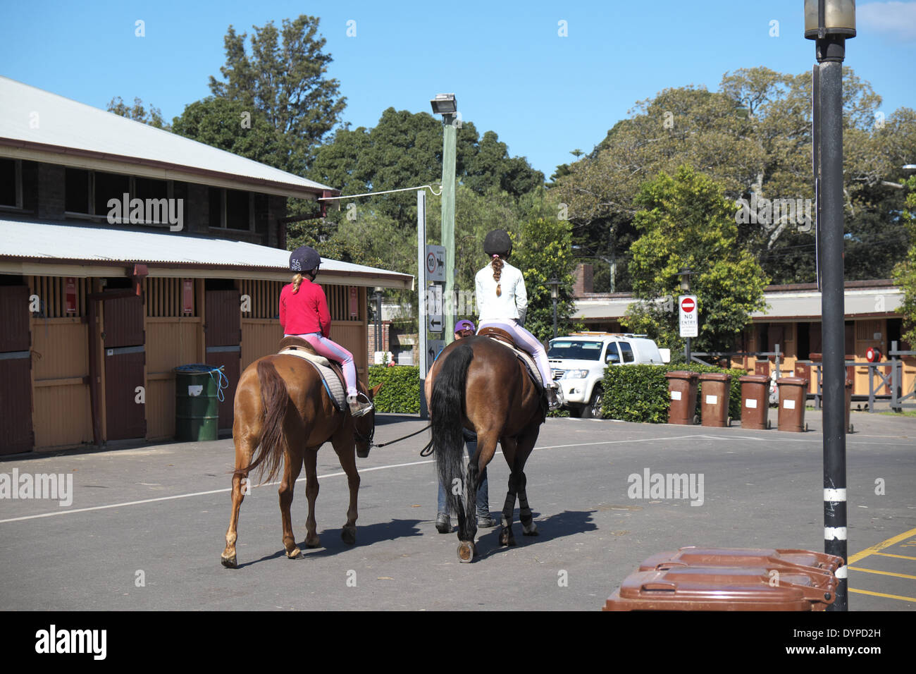 two children riding horses at centennial park equestrian centre and horse stables, eastern suburbs,sydney - Stock Image