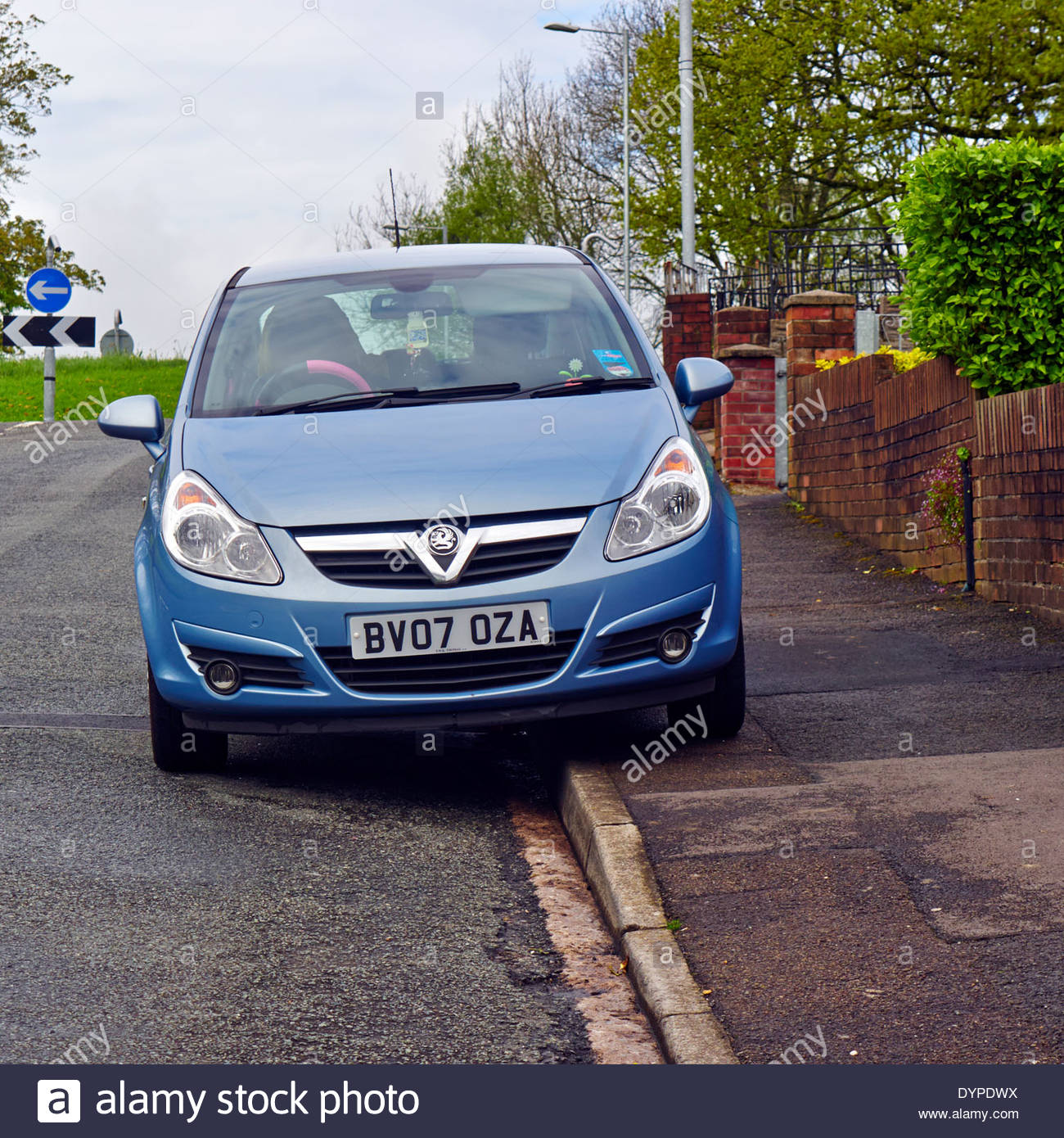 bad inconsiderate driver by parking motor vehicle on the pavement - Stock Image