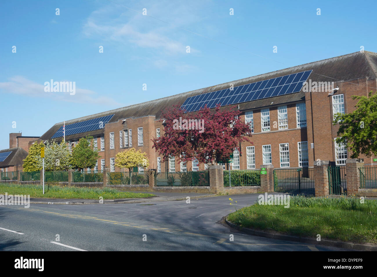 Solar panels on the roof of Helsby High School in Cheshire. - Stock Image
