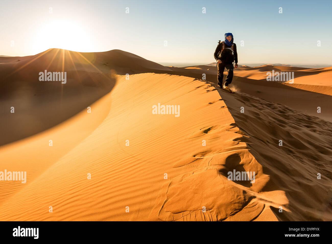 On dunes during sunrise at Erg Chebbi desert, Merzouga, Morocco, Africa - Stock Image