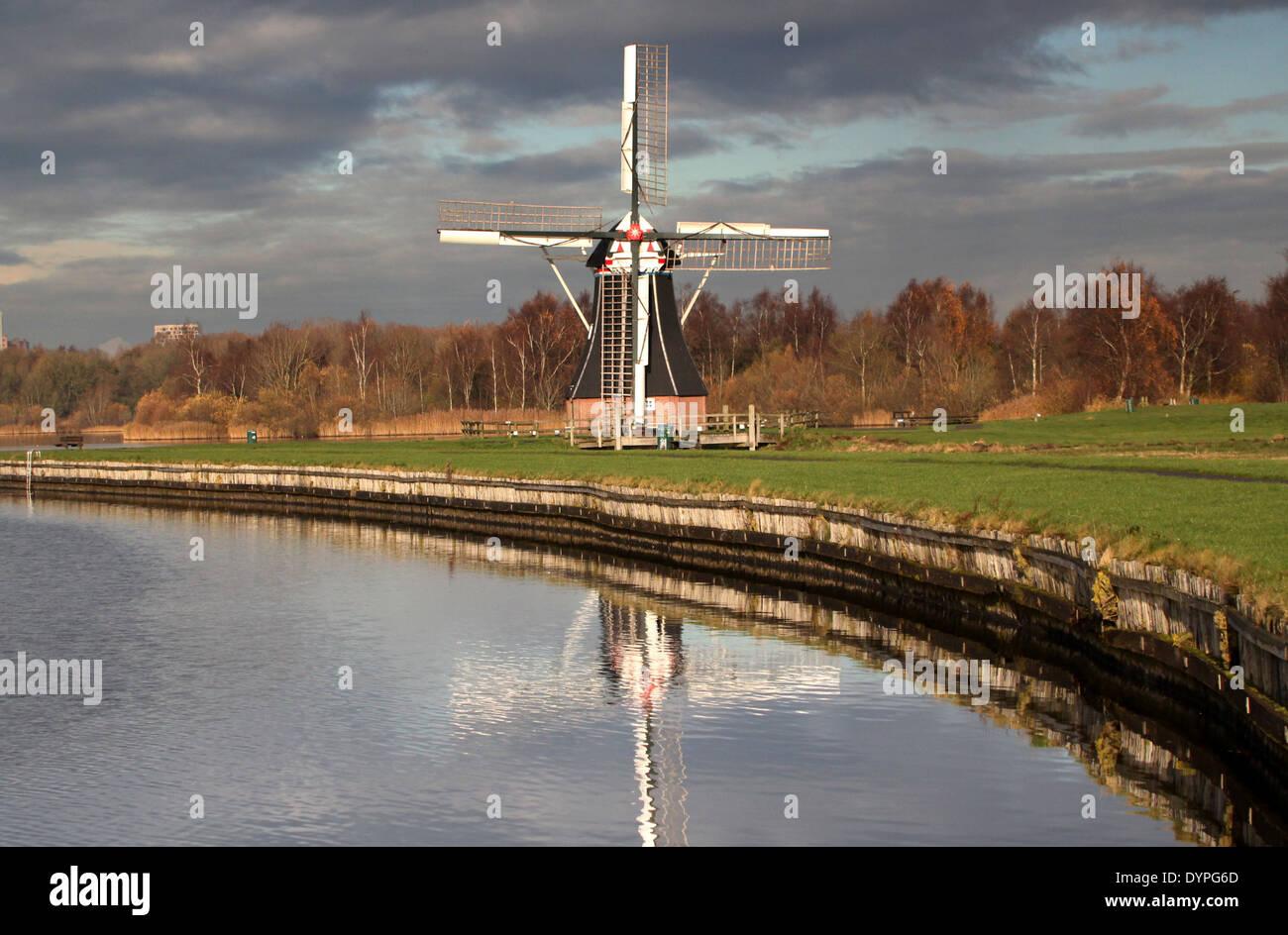 Polder Mill 'De Helper' in Haren,  Groningen, Netherlands, located  on Lake Paterswolde - Stock Image