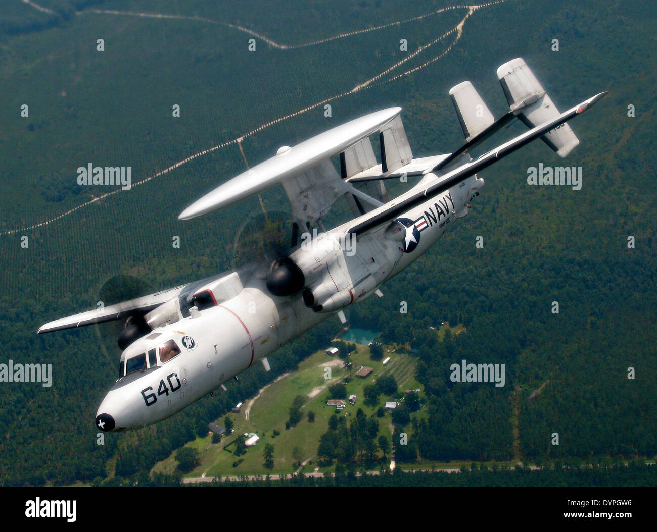 A US Navy E-2C Hawkeye airborne early warning aircraft banks during Field Carrier Landing Practice July 7, 2011 in Jacksonville, Florida. - Stock Image