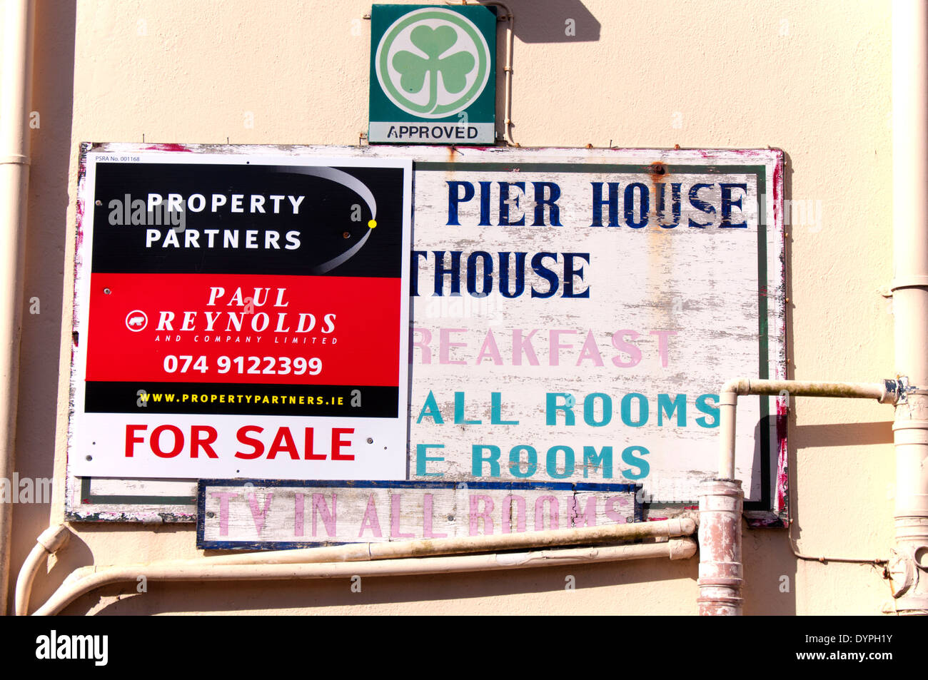 Decaying signage on a bed and breakfast establishment for sale in Burtonport County Donegal Ireland - Stock Image